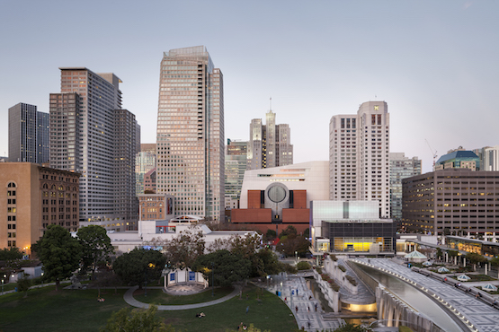 The new SFMOMA Snøhetta-designed building (2016) is visible behind the original red-brick Mario Botta-designed structure (1995).