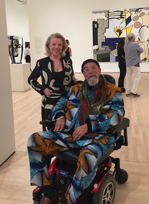 Jeanne Lawrence with artist Chuck Close, whose works of art fill three galleries.