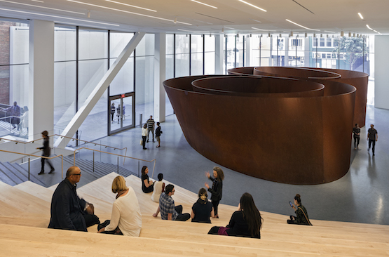 Richard Serra's monumental Sequence. Visitors can sit on the wood staircase opposite the sculpture to rest and contemplate the art.