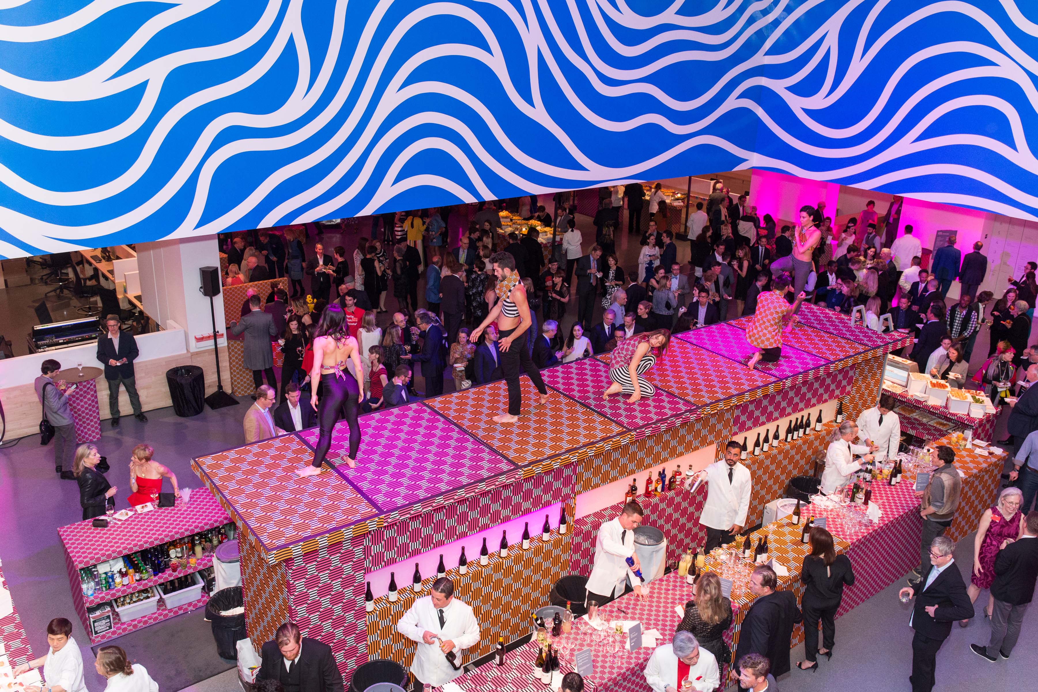 The center of the action was Schwab Hall, where dancers performed on a stage above a long double-sided bar while guests sipped drinks and dined on innovative appetizers.